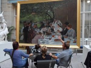 In Rouen's fine city art gallery, a convivial group discuss conviviality.